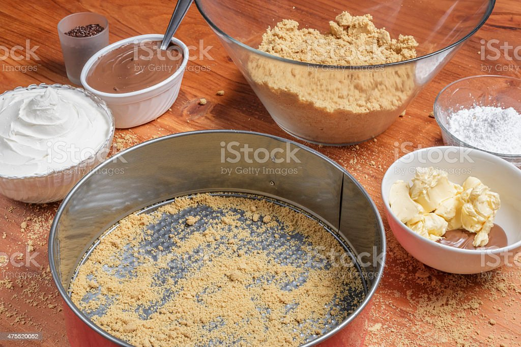 Ingredients for making a chocolate cheesecake on wooden table