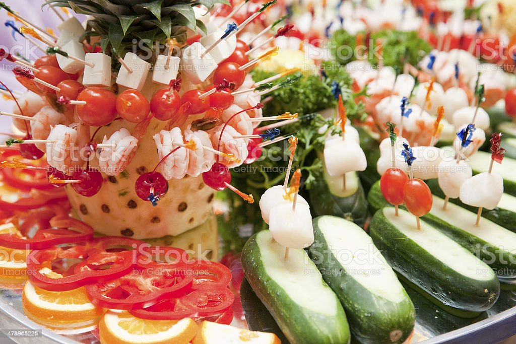 Different kind of canapes at the banquet dessert table stock photo