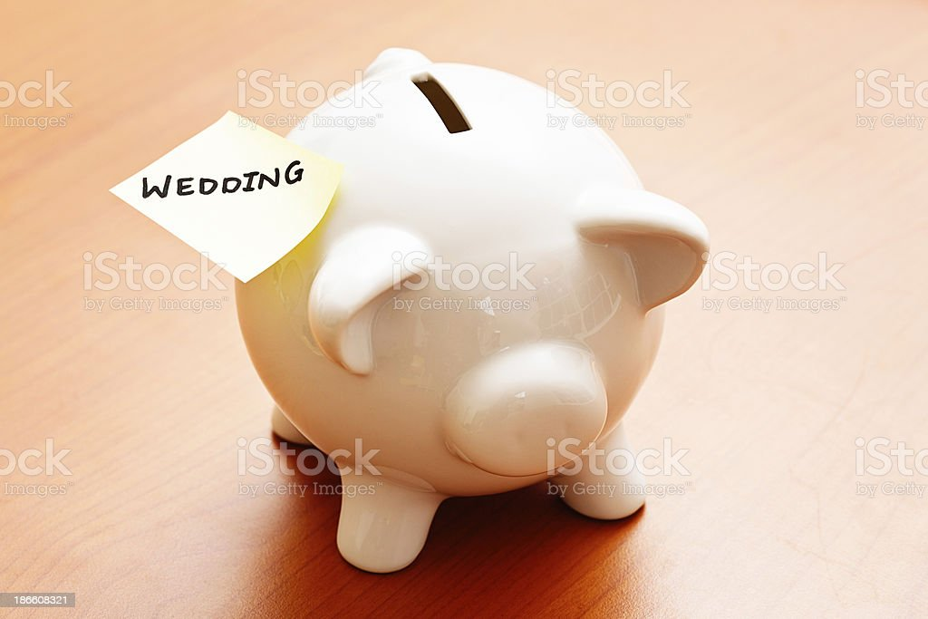 Different kind of Wedding Planner: piggybank with targeted savings plan stock photo