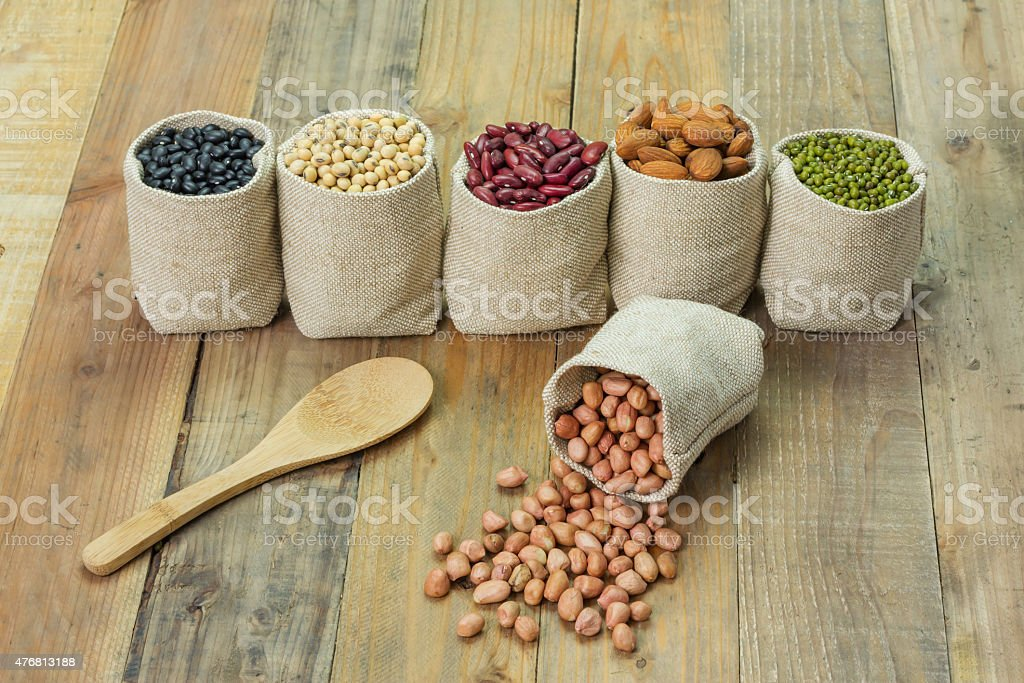 Different kinds of beans in sacks bag royalty-free stock photo