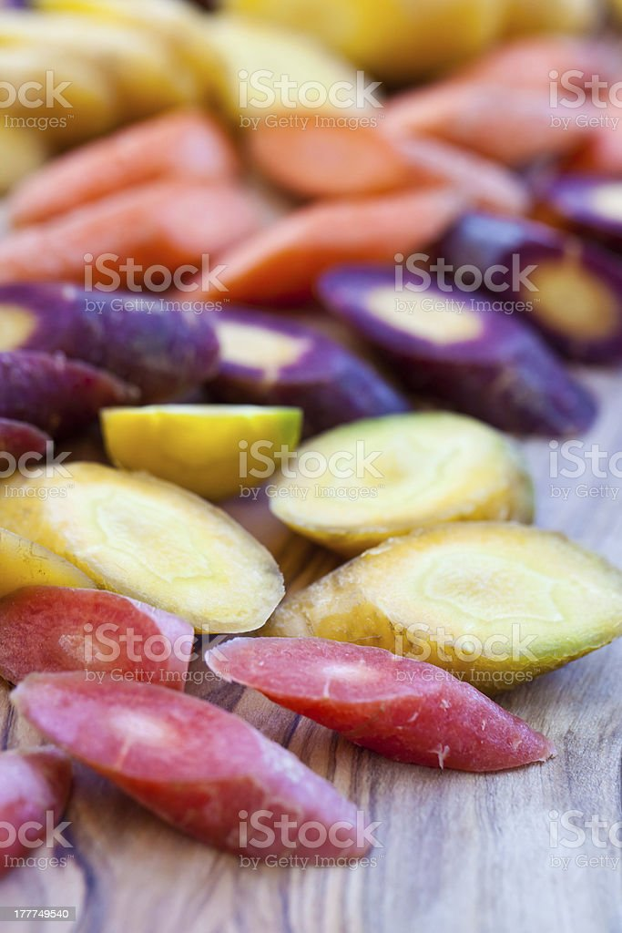 Different kinds of carrot cut on wooden board. royalty-free stock photo