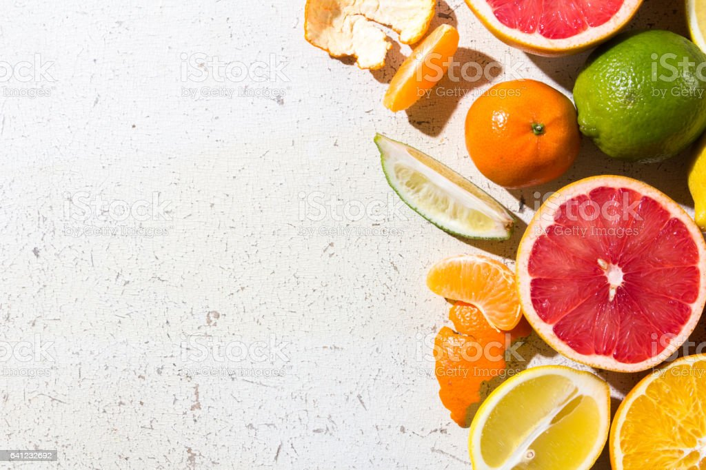 different kinds of citrus on white background stock photo