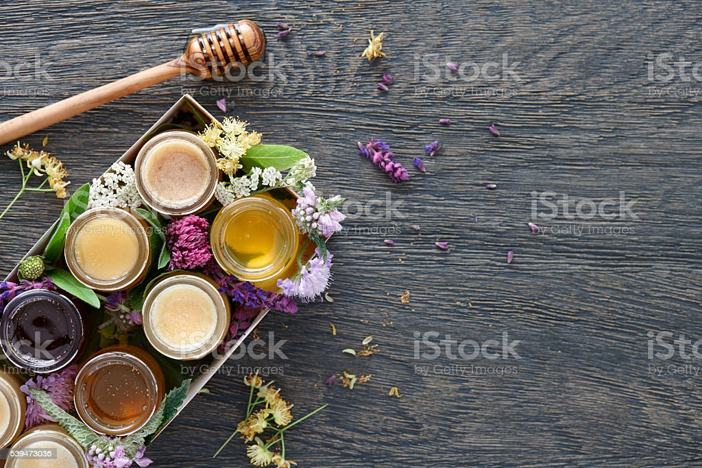 Different kinds of honey in a box stock photo