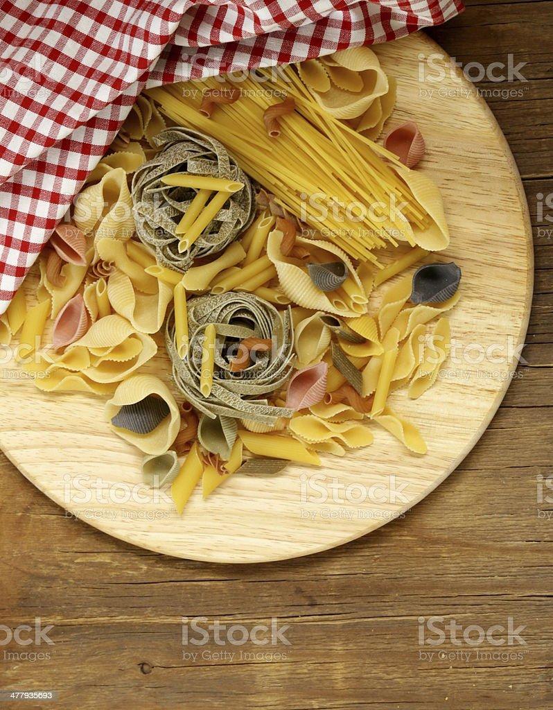 different kinds of pasta (spaghetti, fusilli, penne, linguine) stock photo