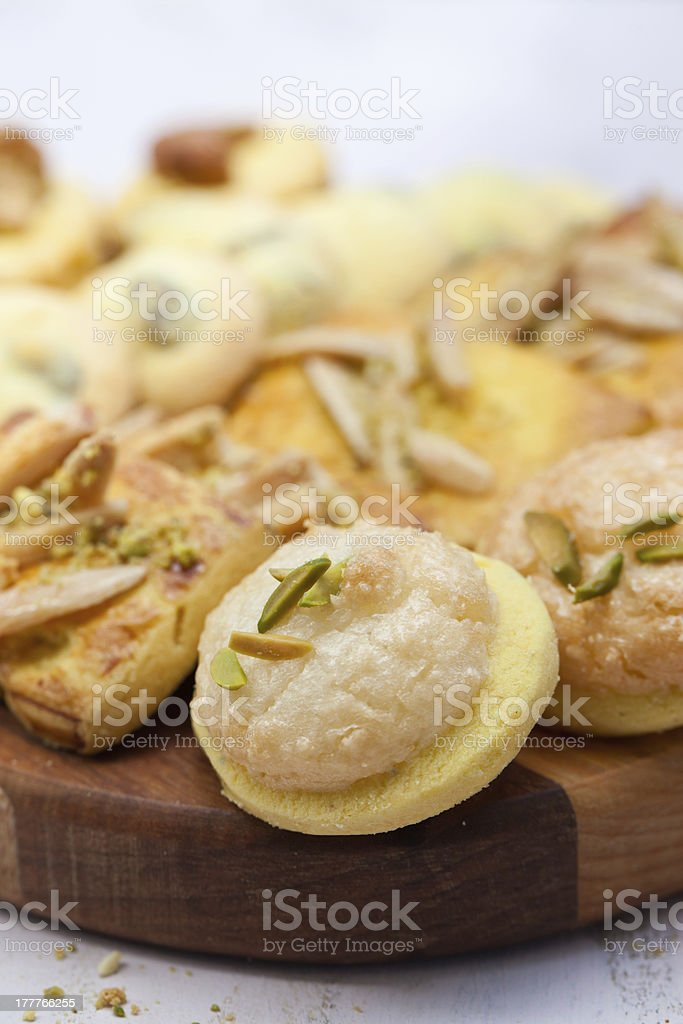 Different kinds of Persian cookies on wooden board. royalty-free stock photo
