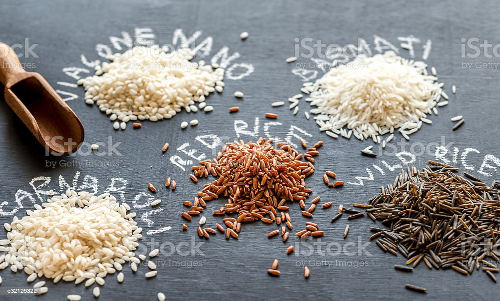 Different kinds of rice on the dark background stock photo