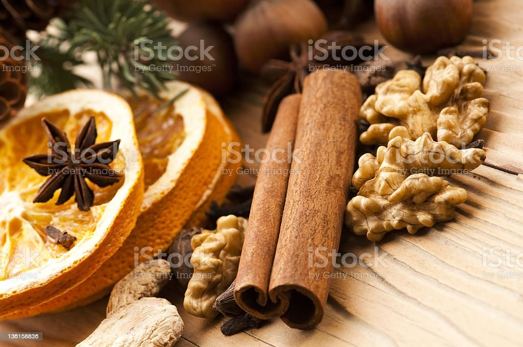 Different kinds of spices, nuts and dried oranges royalty-free stock photo