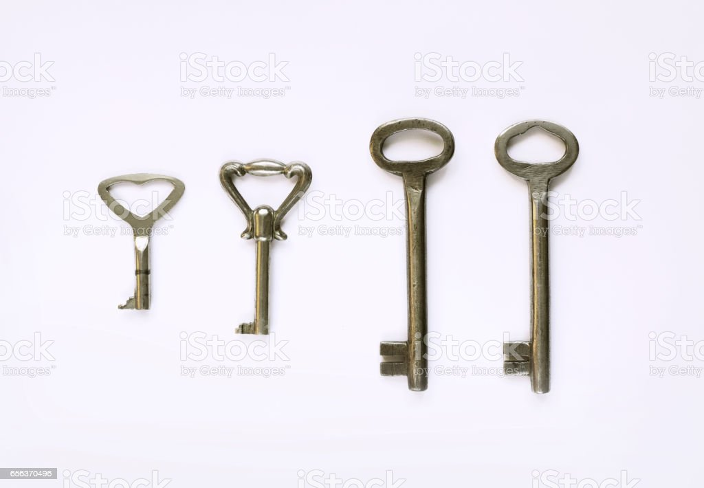 Different kinds of vintage keys on white background stock photo
