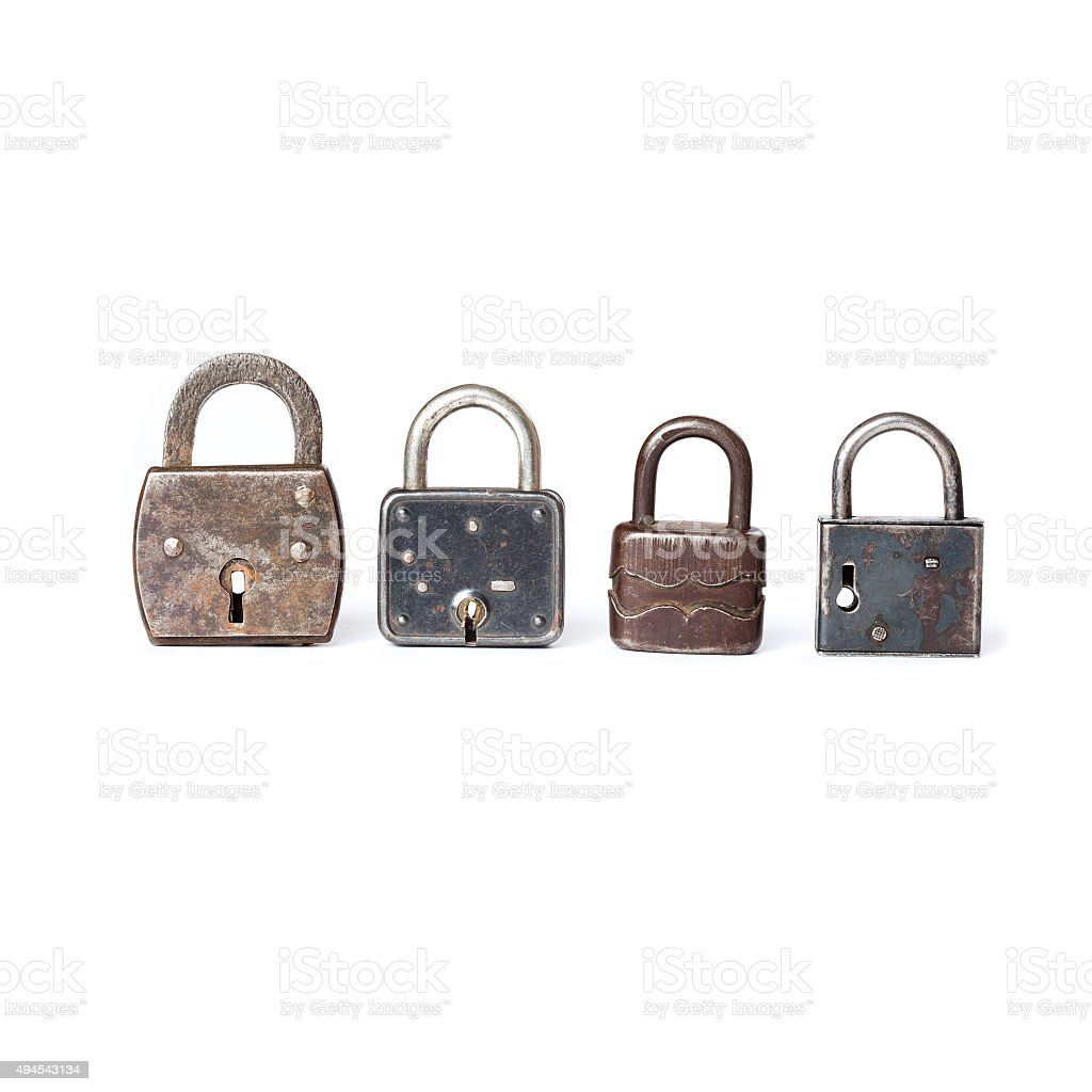Different kinds padlocks with key hole. White background stock photo