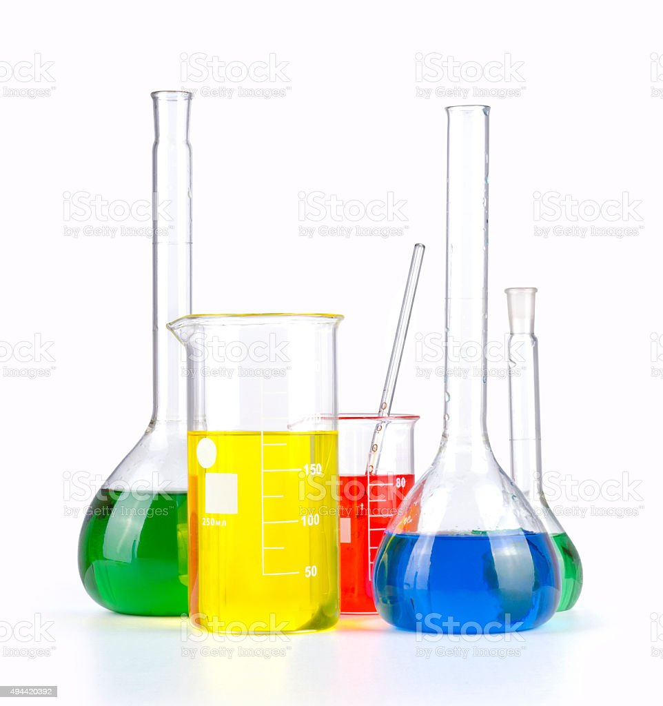 Different laboratory glassware with colored liquid stock photo