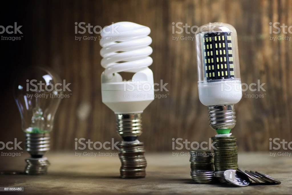different lamp on coin savings concept stock photo
