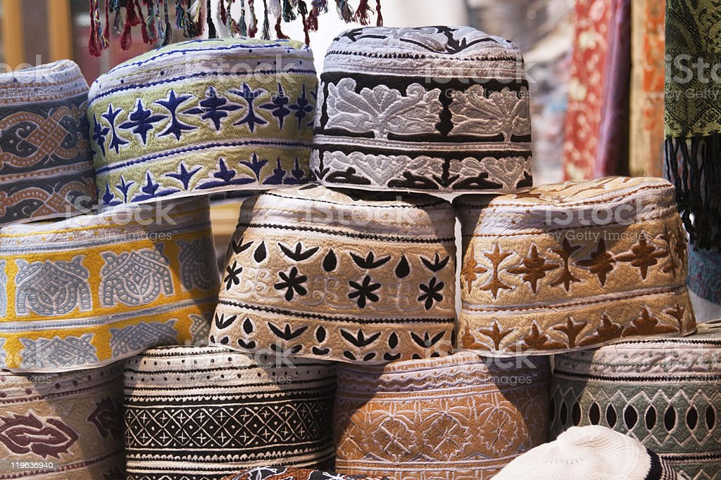 Different men's caps featured in Oman stock photo