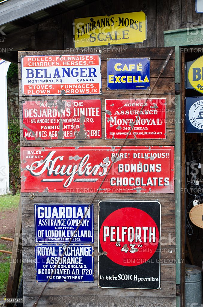 Different metal signs in an Antique Store stock photo