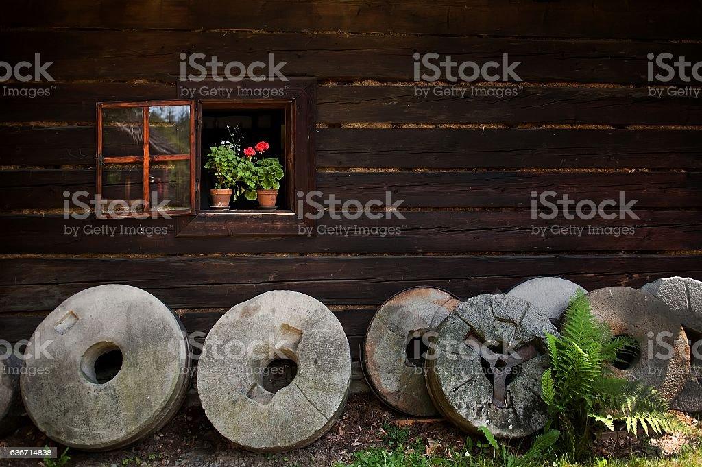Different millstones in village stock photo