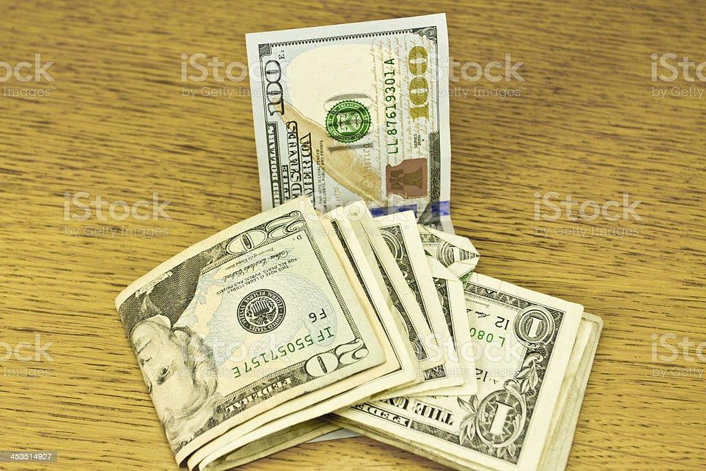 Different money denomination with new $100 dollar bill stock photo