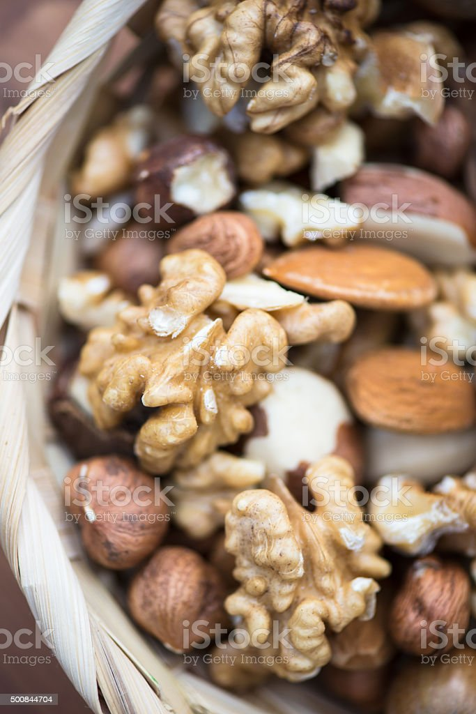 Different Nuts and Nutcracker stock photo