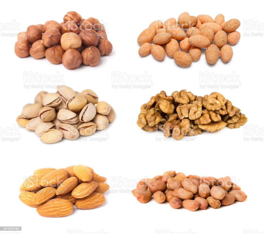 Different nuts in heaps isolated on white stock photo