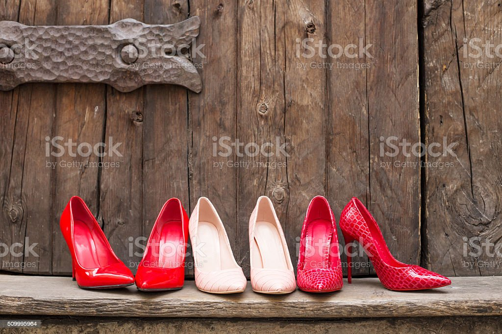 Different pairs of high heel shoes stock photo