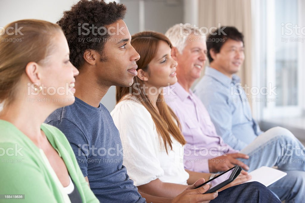 Different people attending a support group stock photo