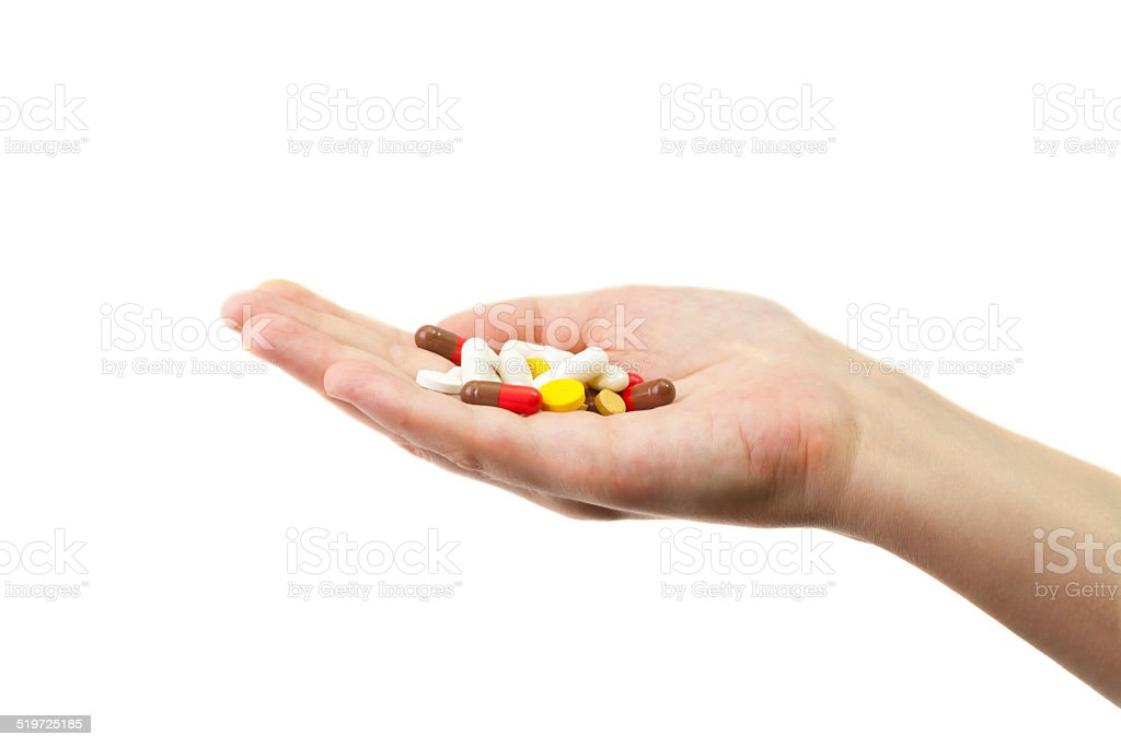 Different pills lying in the hand stock photo