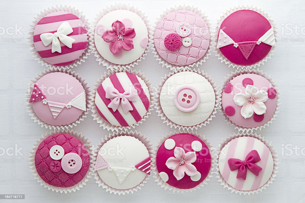 Different pink cupcake designs stock photo
