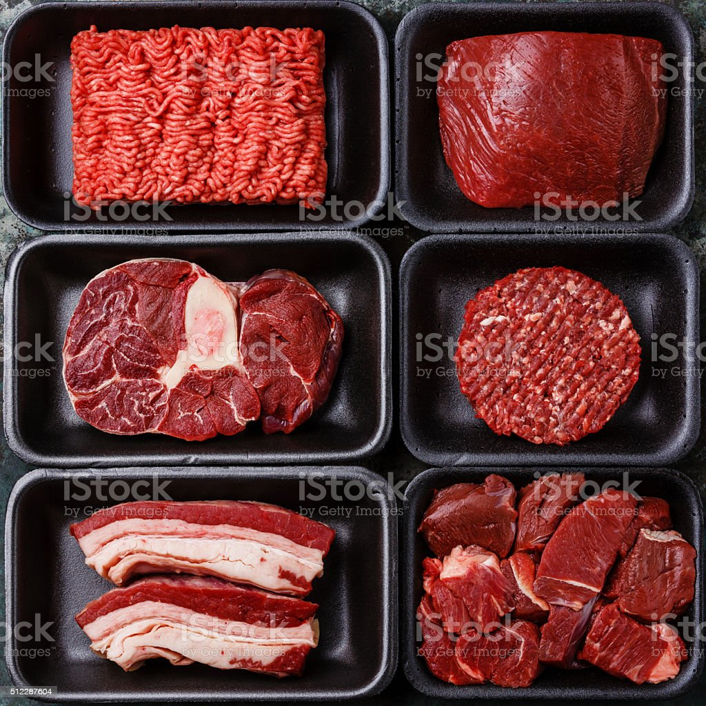 Different raw meat in plastic boxes stock photo
