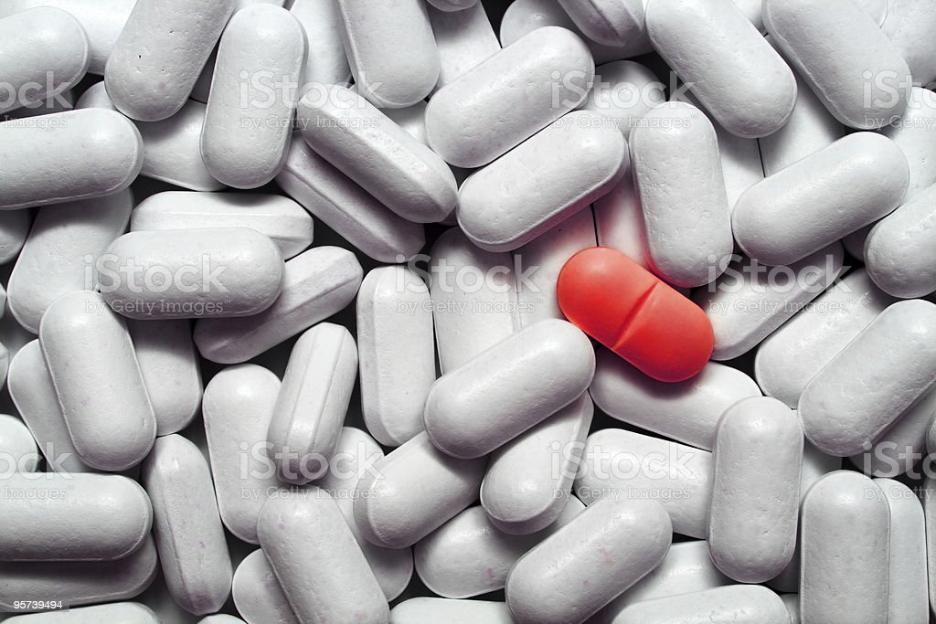 different - red pill among pills royalty-free stock photo