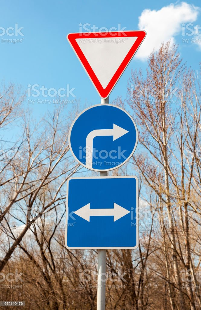 Different road signs against the blue sky stock photo