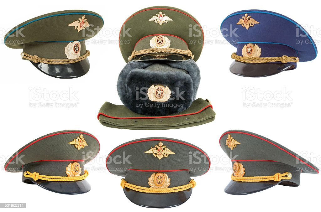 Different russian army officers caps over white background stock photo
