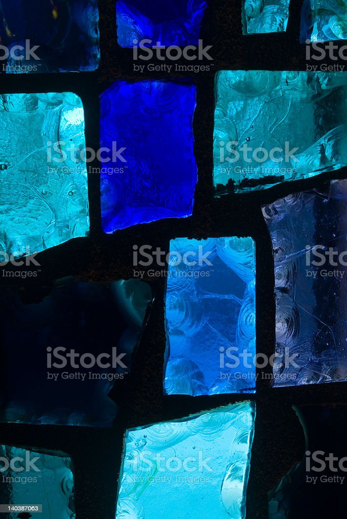 Different shades of blue in stained glass panels royalty-free stock photo