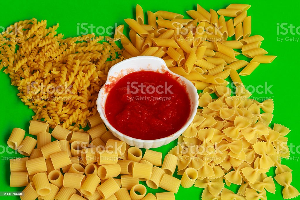 different shapes of pasta with red sauce stock photo