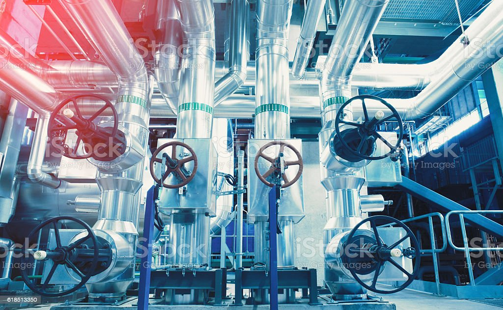 different size and shaped pipes and valves stock photo