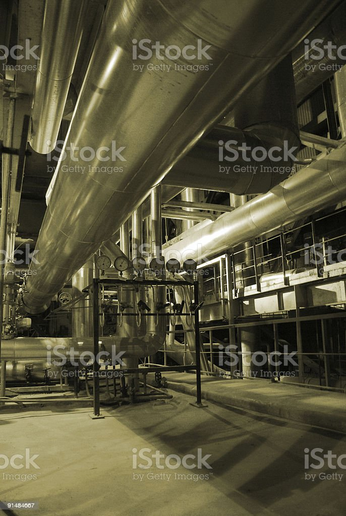different size and shaped pipes at a power plant. royalty-free stock photo