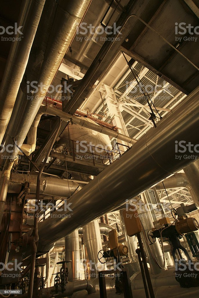 different size and shaped pipes at a power plant royalty-free stock photo