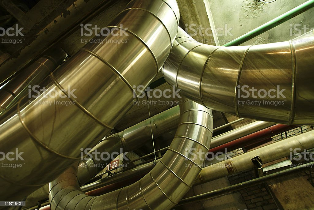 different size shaped pipes valves at a power plant royalty-free stock photo