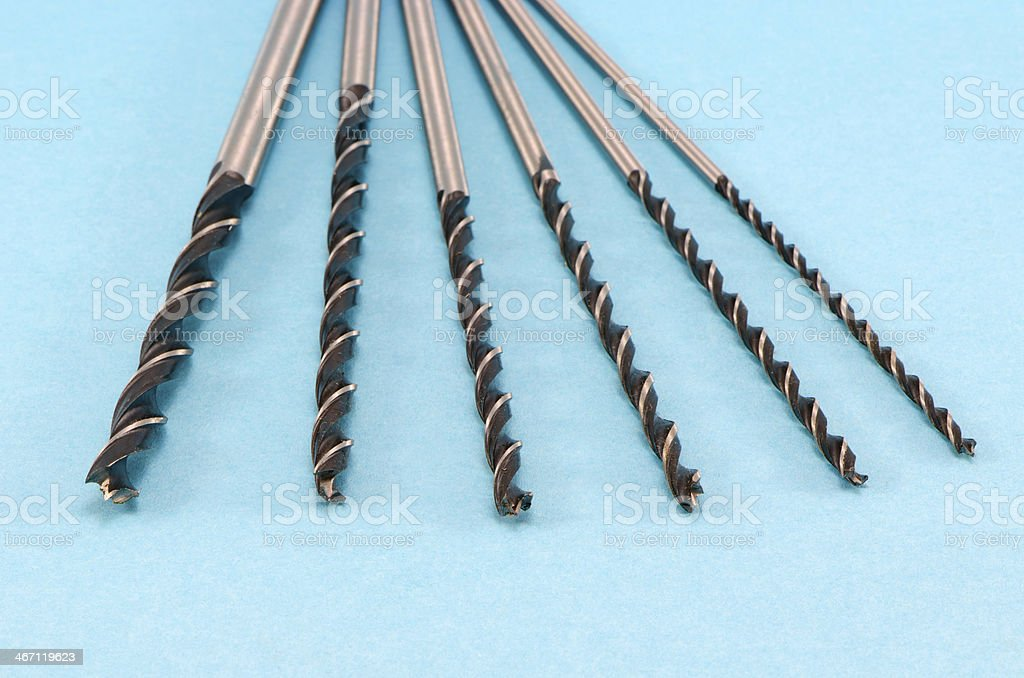 different size special wood drill bits on blue royalty-free stock photo