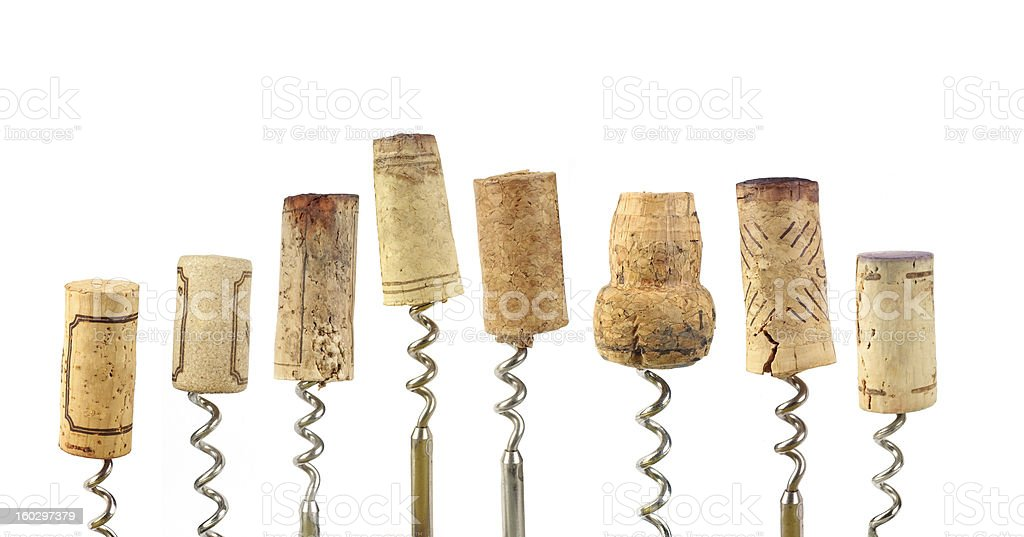 Different size wine corks with the corkscrew in each of them stock photo