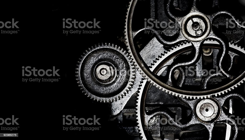 Different sized gears interlocked stock photo