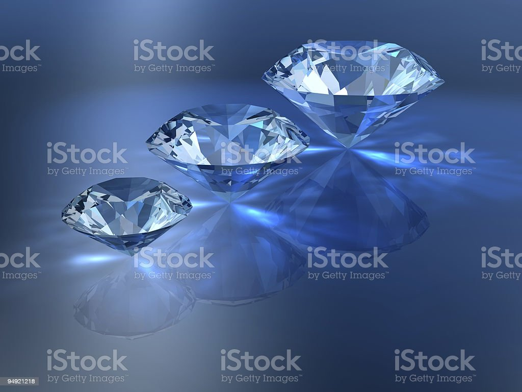 Different sizes diamonds being reflected on the table royalty-free stock photo