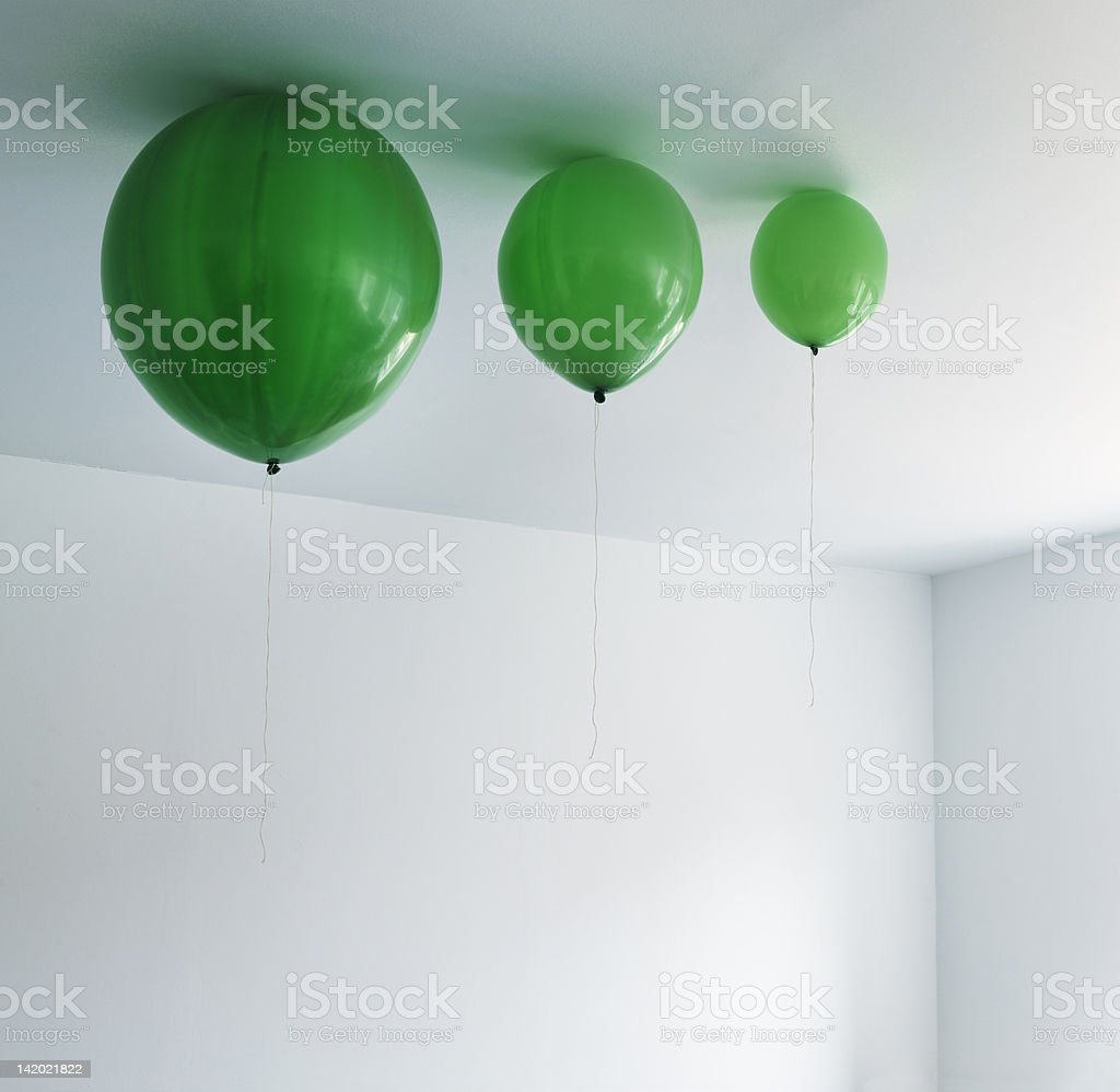 Different sizes of balloons on ceiling stock photo