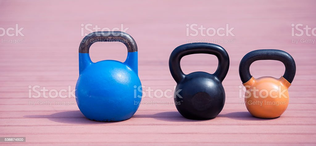 Different sizes of kettlebells. stock photo