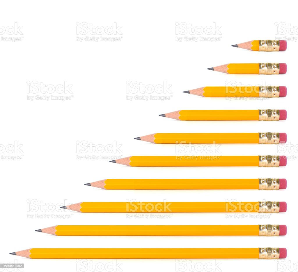 Different sizes of yellow pencils on white background stock photo