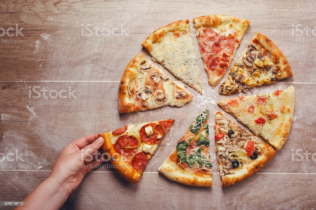 Different slices of pizza stock photo
