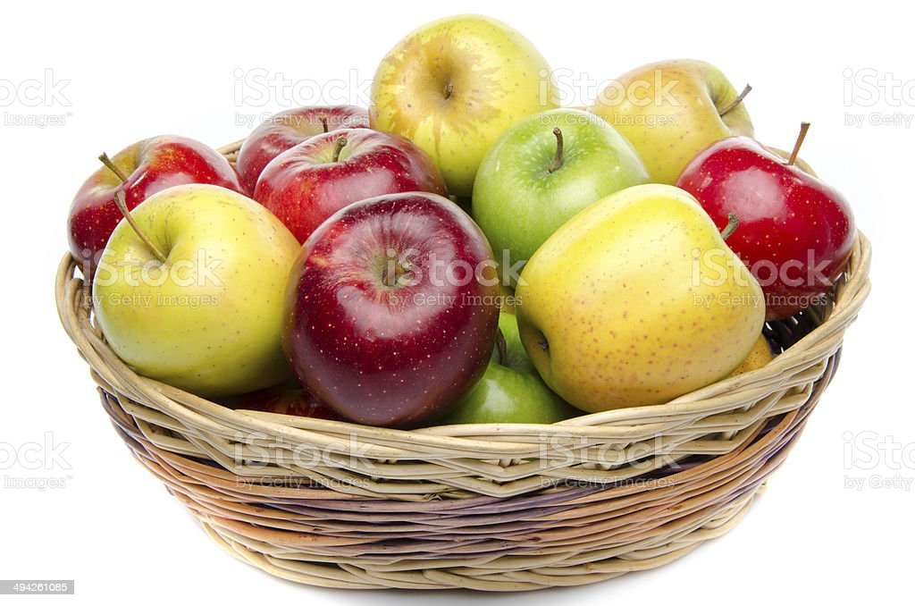 Different sorts of apples in a basket stock photo