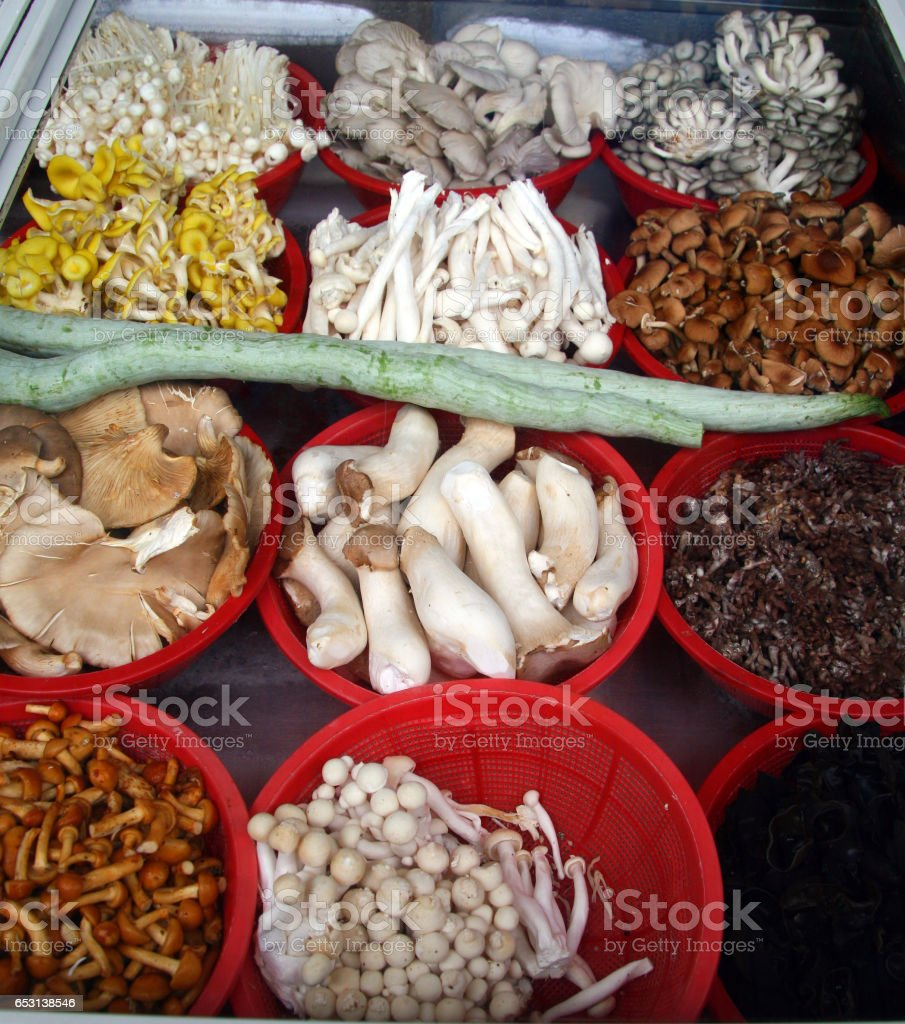 12 different species of fungi on the counter of a small Chinese restaurant, Wuyishan, China stock photo