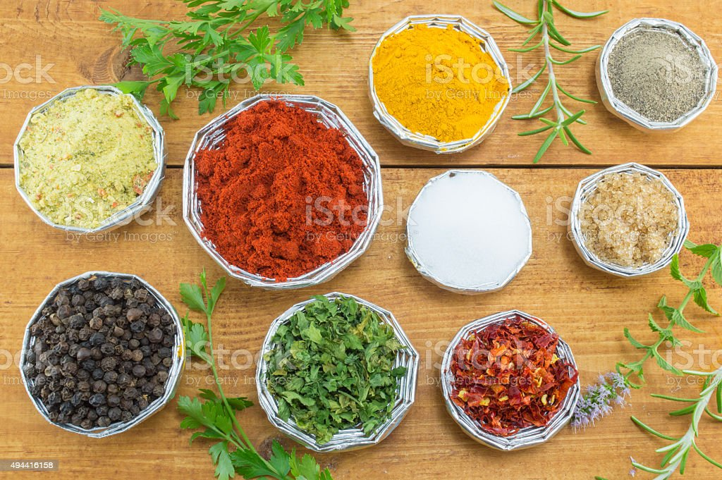 Different spices in shiny bowls stock photo
