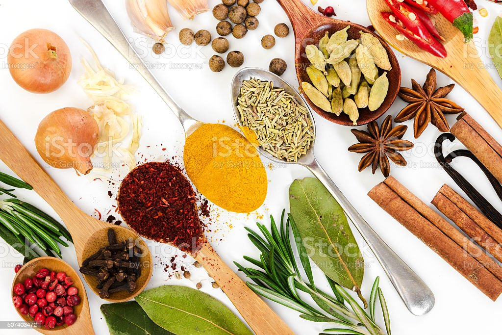 Different spices in spoons on white background. stock photo