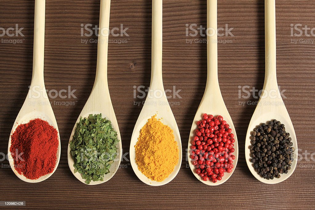 5 different spoonfuls of different spices royalty-free stock photo