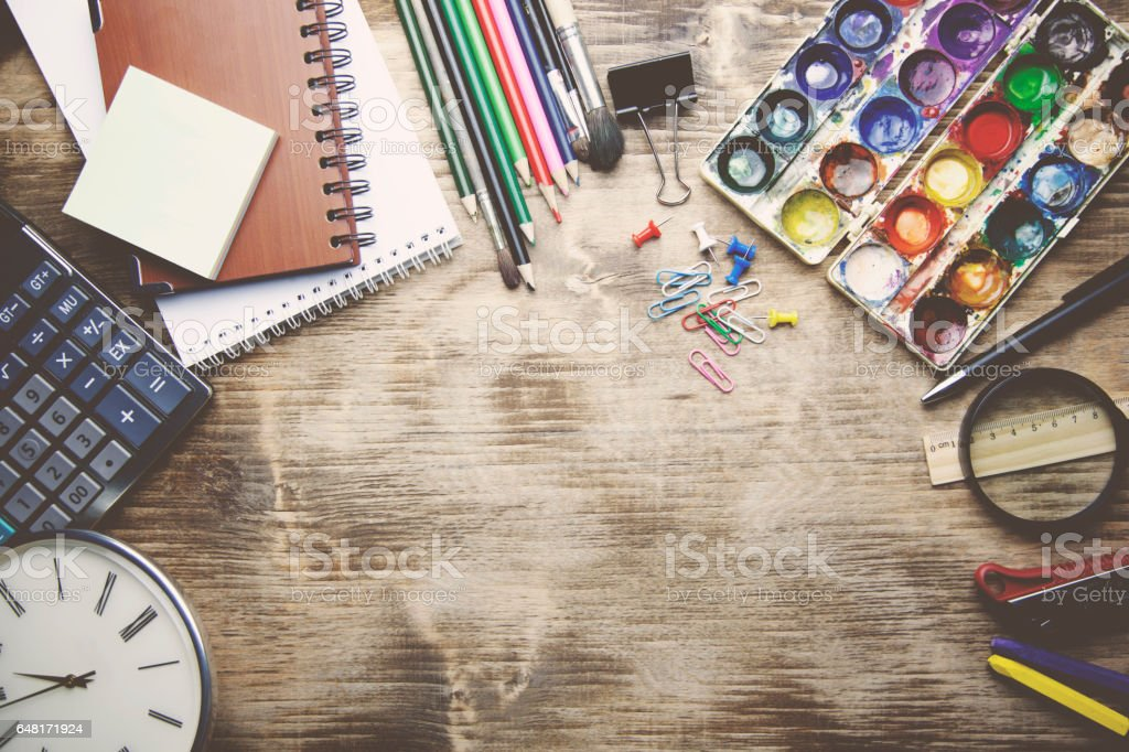 different stationery on the wooden table stock photo