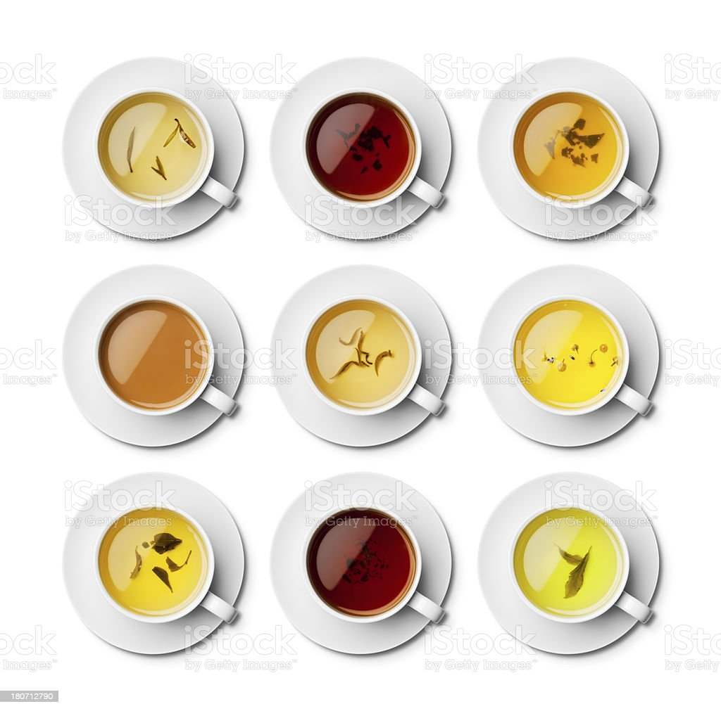Different teas in white cups with saucers overhead royalty-free stock photo